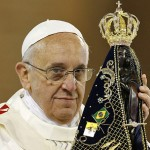 Pope Francis hold statue of Mary during Mass at Basilica of the National Shrine of Our Lady of Aparecida